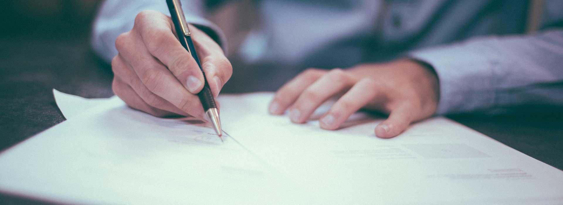 Signing paperwork photo